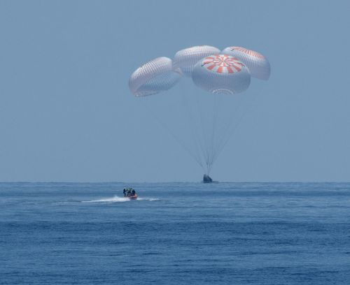 Astronauts back on Earth after 'extraordinary' Dragon test flight