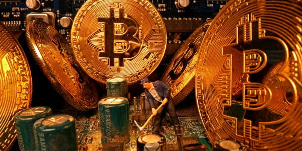 Bitcoin has 'considerable' upside as it better competes with gold as alternative currency, JPMorgan says