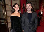 Simon Cowell looks slimmer than ever as he cosies up to Lauren Silverman at & Juliet musical event