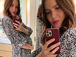 Mandy Moore cradles her baby bump in a lovely black and white floral maternity dress