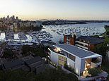 Neighbourhood war erupts over crane sign which obscured another resident's harbour views