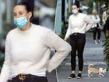 The Bachelor's Stevie Grey dons a face mask as she goes for a stroll