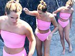 PICTURE EXCLUSIVE: Emma Watson slips into a neon pink bikini for a day of sunbathing in Positano
