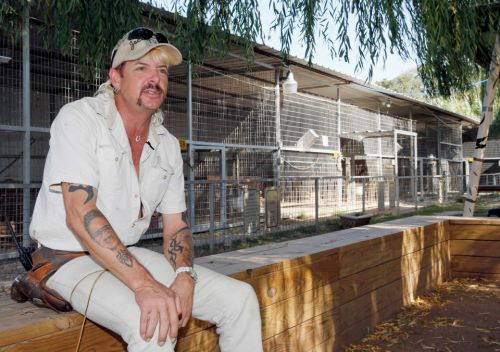 Trump vows to 'take a look' at Tiger King Joe Exotic's conviction after asking WH reporters if he should PARDON him