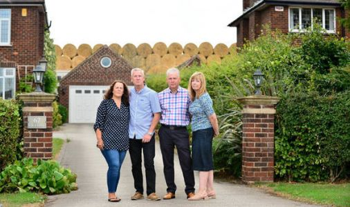 £500,000 homes 'blighted' by 30ft wall of hay