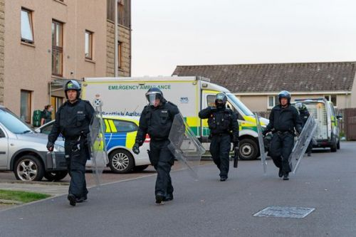 Cops armed with riot shields swoop on Moray street as man arrested