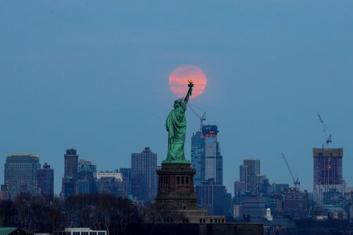 The first 'Equinox Supermoon' for 19 years captured around the world in stunning pictures