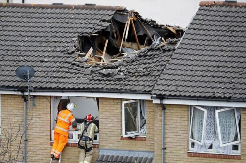 Body of elderly woman killed when crane collapsed into home still trapped inside