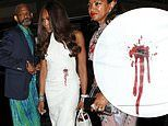 Naomi Campbell makes a bold statement in a bullet hole print dress at Fashion For Relief after-party