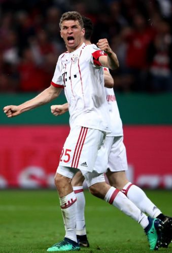 Bayer Leverkusen 2 Bayern Munich 6: Bundesliga winners on course for treble after Thomas Muller's hat-trick fires visitors into DFB-Pokal cup final