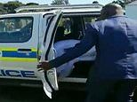 Bride and groom are bundled into a police car after breaking coronavirus lockdown in South Africa