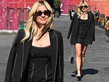 Ashley Roberts puts on a leggy display in a chic black mini dress and coordinating blazer