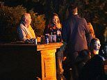 Real ale drinkers use headstones as seats and tables as they hold beer festival in graveyard