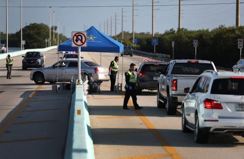 Florida police are setting up highway checkpoints to enforce the state's coronavirus quarantine. Offenders could be jailed for 60 days
