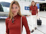 Martha Hunt leaves Nice in casual white trousers and sandals after Cannes Film Festival