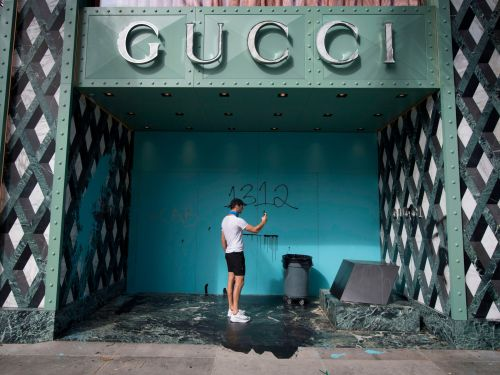 Shattered storefronts and 'eat the rich' graffiti: Photos show the aftermath of destruction in luxury stores that were looted and vandalized during the protests