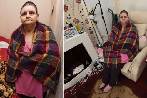 Mum dying from ovarian cancer is forced to take ice cold showers for 14 months