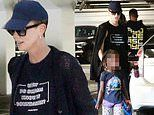 Charlize Theron goes incognito in black with daughter August while promoting new film Bombshell
