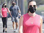 Lea Michele looks sporty in pink athleisure while power walking in LA with husband Zandy Reich