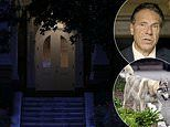 Holed up Cuomo refuses to leave the Governor's mansion for SECOND day - but his Malamute gets a run