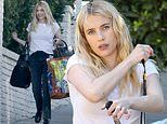 New mom Emma Roberts keeps it classic in black jeans and a white tee as she heads to a shoot in LA