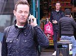 Stephen Mulhern stocks up on supplies at Poundland during UK COVID-19 lockdown