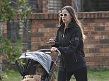 Former Big Brother star Krystal Forscutt takes a stroll with her daughter in Cronulla