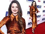 Selena Gomez shines in a lustrous orange dress at the ACLU Southern CaliforniaBill of Rights Dinner