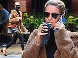 Nicky Hilton sips on a drink while chatting on her phone as she runs errands in warm coat in NYC