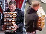 Dutch football fan, 23, goes viral after he was caught carrying 48 PINTS of beer in one go at game
