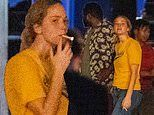 Jennifer Lawrence smokes a cigarette while filming a bar scene with Brian Tyree Henry