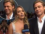 Brad Pitt gave a flirty wink to Extra host Renee Bargh during a cheeky SAG red carpet chat