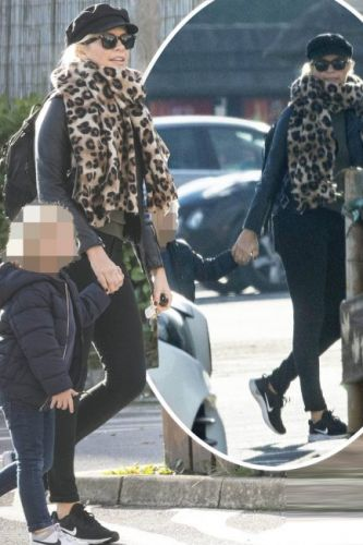 Holly Willoughby dresses down as she makes rare appearance with son Chester before I'm A Celebrity stint in Australia