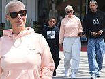 Amber Rose holds hands with son Sebastian, 8, on lunch outing with boyfriend AE Edwards in LA