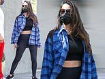 Olivia Munn showcases her toned midriff in crop top and leggings with blue plaid button up in LA
