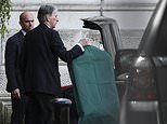 Philip Hammond is seen packing his bags outside Downing Street