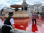 Trafalgar Square fountains turn blood red as Animal Rebellion activists pour in dye