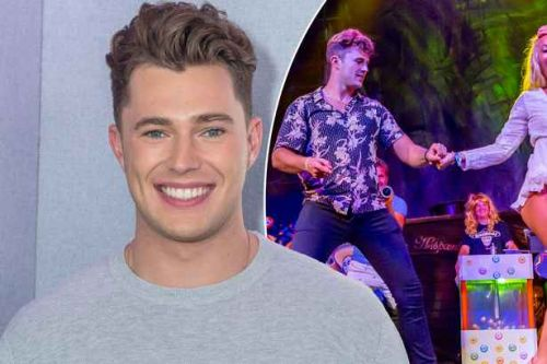 Curtis Pritchard dances with mystery girl on Magaluf night out- as Love Island girlfriend Maura stays at home