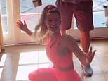 Christine McGuinness displays her figure in hot pink gym gear as she films another TikTok video