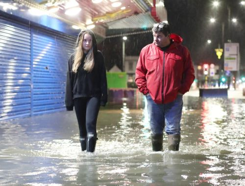 Cars abandoned in floods and stations closed as Storm Aurore lashes UK