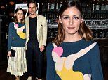 Olivia Palermo wears a sweater with a diver emblazoned on it to film screening with Johannes Huebl