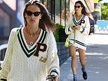 Alessandra Ambrosio puts on a leggy display in denim cut-offs teamed with a plunging cricket jumper