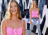 Nina Agdal stands out in bubblegum pink crop top at party celebrating AE x Young Money collection