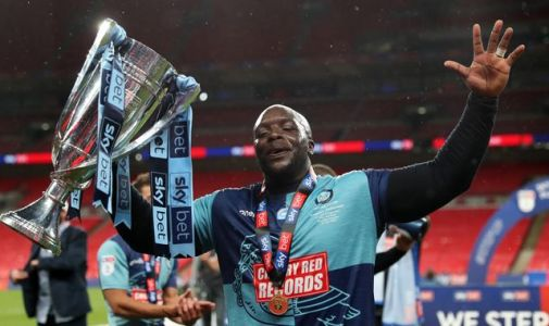Jurgen Klopp congratulates Adebayo Akinfenwa after Wycombe's play-off success