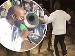 Kanye West dances and raps with locals while visiting Haiti