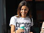 Julia Bradbury laughs up a storm with a pal over coffee. following breast cancer diagnosis