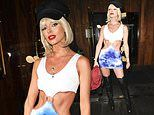 Maura Higgins flashes her washboard abs as she channels a Pretty Woman vibe for Halloween bash