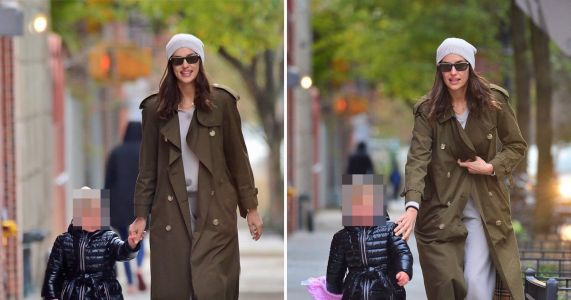 Irina Shayk tries to hold back Lea as daughter attempts to run for it following Halloween with Bradley Cooper