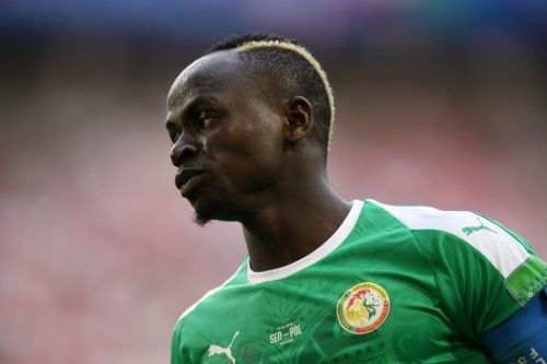 Sadio Mane helped off the pitch in tears after Senegal fans boo missed chance
