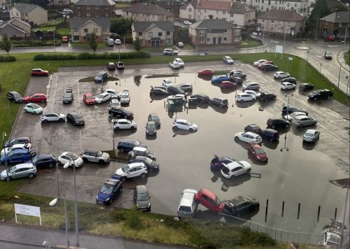 Cars float off in hospital car park as violent storms batter UK in heatwave